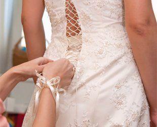 A wedding dress fitting in progress