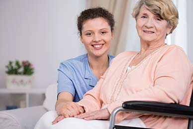Smiling elder woman sitting on a wheelchair
