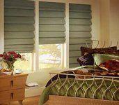 Roman window coverings in bedroom