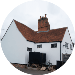 A white painted house with reclaimed heritage tiles