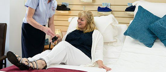 Woman testing out a Safe Hands bed in-store