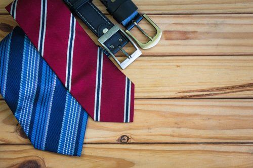 Tie and belt on wooden board
