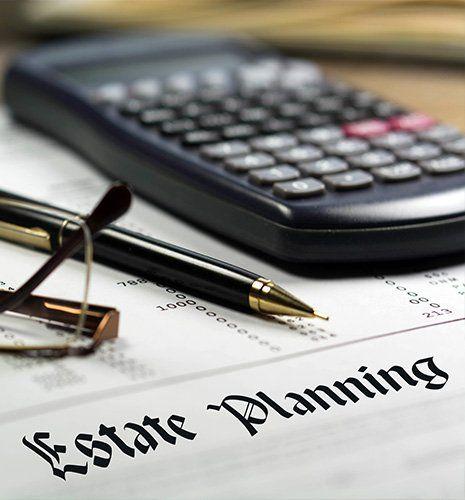 Estate planning, calculator, glasses and black pen