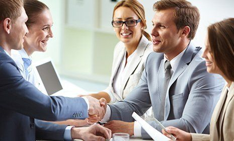 Businessmen handshaking at meeting