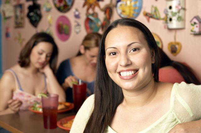 Friends eating at our Filipino cuisine restaurant in Wailuku, HI