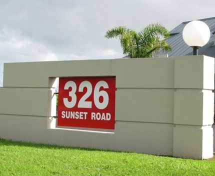 Concrete exterior wall with house number plate