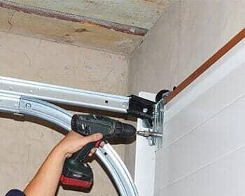 Contractor Installing Garage Door U2014 Garage Doors In Billings, MT