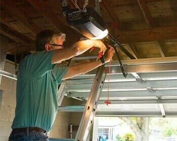 A Man Working On Automatic Garage Door U2014 Garage Doors In Billings, MT