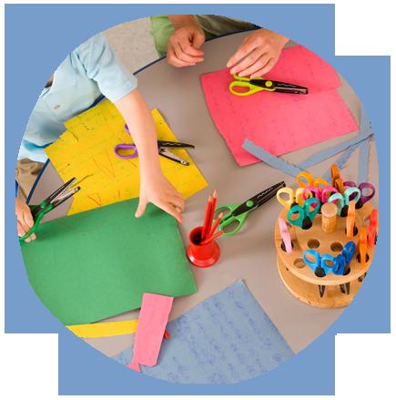 nursery children cutting papers