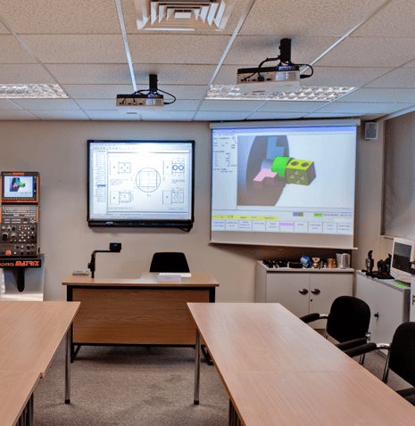 Classroom with two projectors showing images on screens