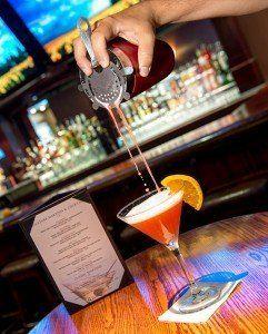 Mixing martinis with orange slices