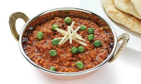 Piatto indiano di keema curry con naan a Castelfranco Emilia