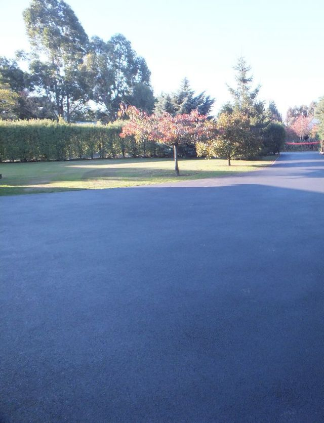 Asphalt driveways in front of houses in Christchurch