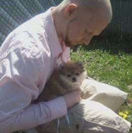 boy holding small Pomeranian
