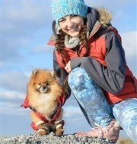 pomeranian-with-young-girl