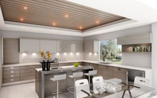 A modern kitchen with white counters and spotlight lighting