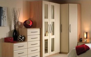 A stylish bedroom with large wardrobes and matching drawers