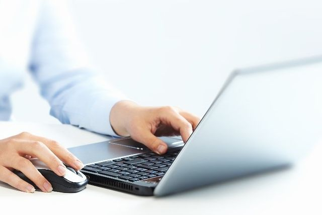 close up of typing on a laptop