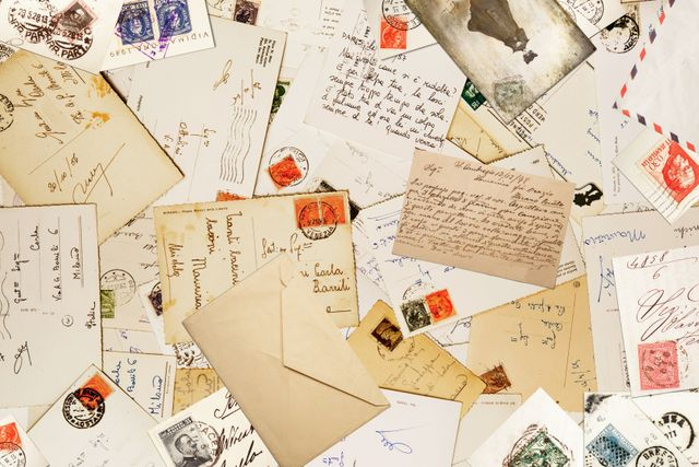 table full of letters and postcards