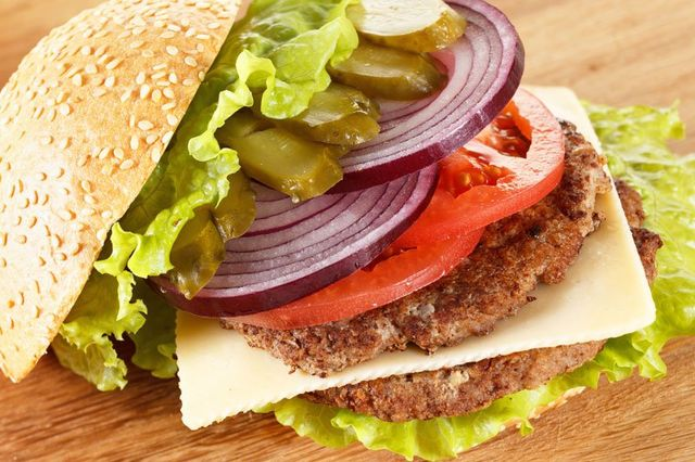 Vegetables and a patty on a bun