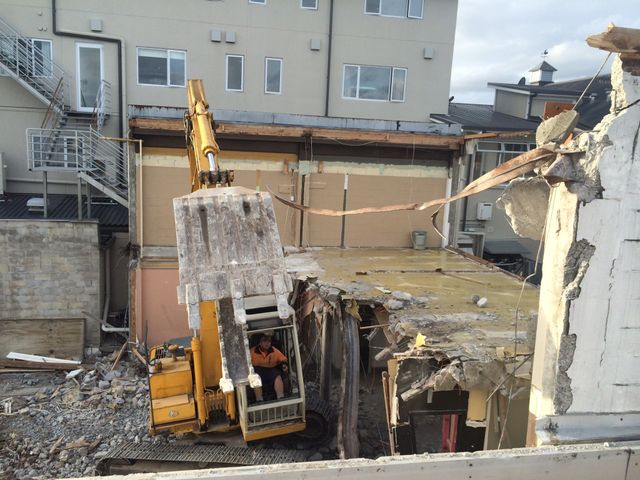 Demolition being done with the help of machine