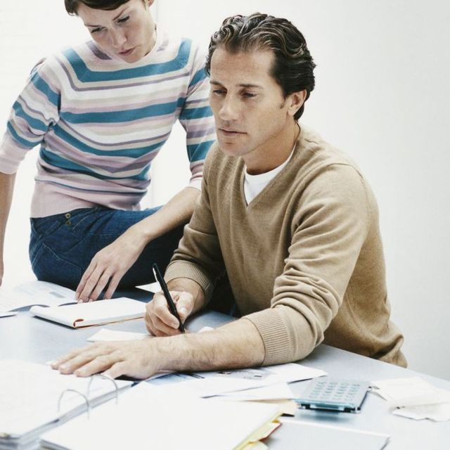 Father reviewing investment plans for son's future