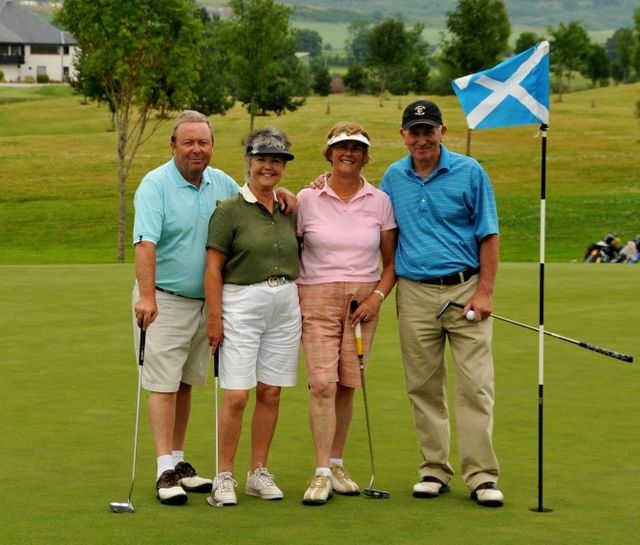 Players playing golf at the scottish golf course