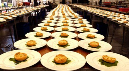 Starters on rows of white plates