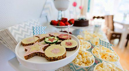 Crispy cakes and popcorn on a table with a plate of strawberries