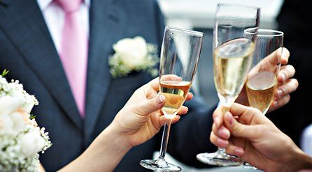 Wedding guests holding champagne flutes