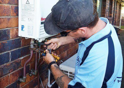 slim flow employee working on water heater