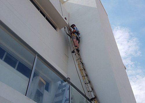 man climbing on ladder