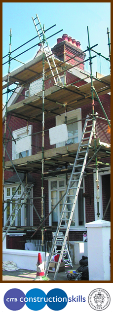 Building repairs being carried out on two storey house