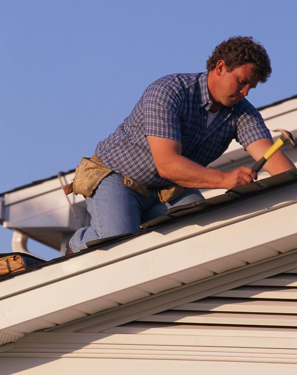 One of our roofing professionals at work in Bellevue, KY