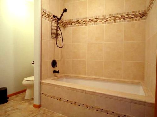 Modern bathroom with tiles, provided by a tile contractor in Anchorage, AK