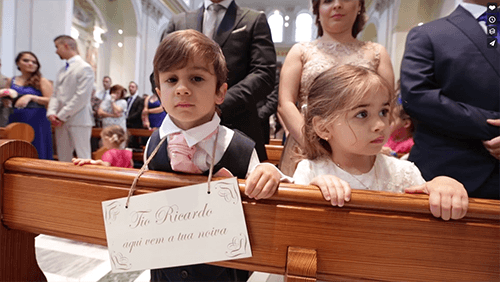 two children in a church at a wedding