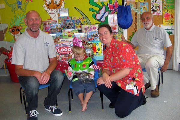Eager hands get to grips with Steve and Glyn's delivery of toys at the Rainbow Ward at the QEQM Hospital Margate.