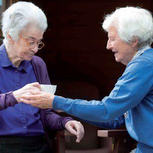 2 elderly women socialising