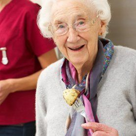 Elderly woman eating a meal