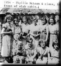 1954 - Phyllis McLean & class in front of slab cabin