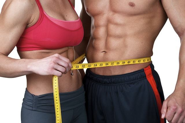 Personal Trainer Cardiff | male and female models  with six packs