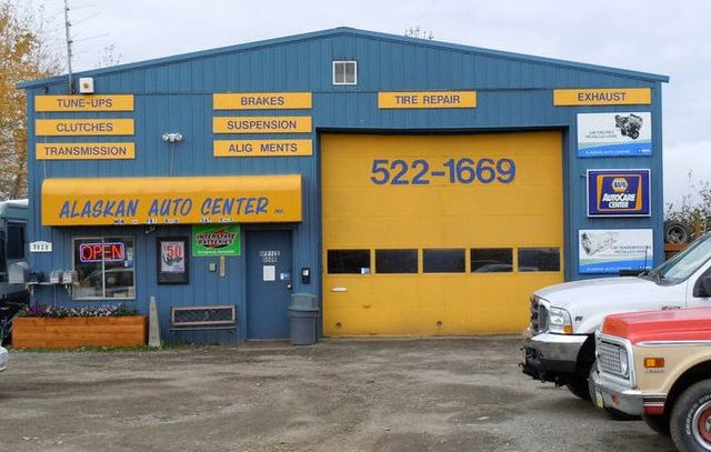 An auto repair specialist with customer in Anchorage, AK