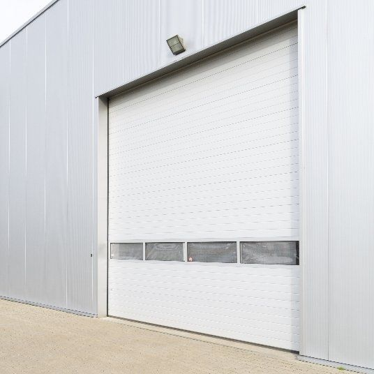 Garage Door Repairs and Maintenance at a Low Cost