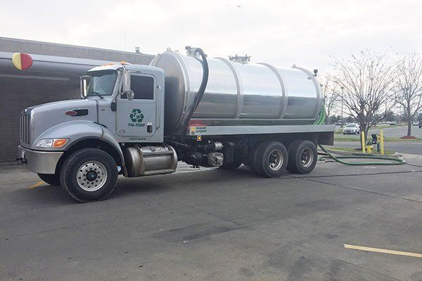 Sewage truck on city street in working process to clean up sewerage overflows