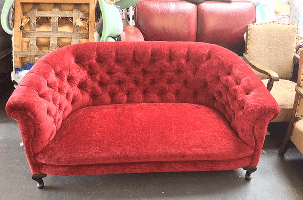 Red sofa seat repaired by experts
