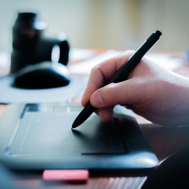 Designer with wacom tablet Conner Instant Printing Inc