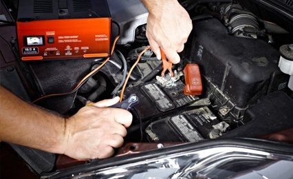 a mechanic carrying out engine diagnostics