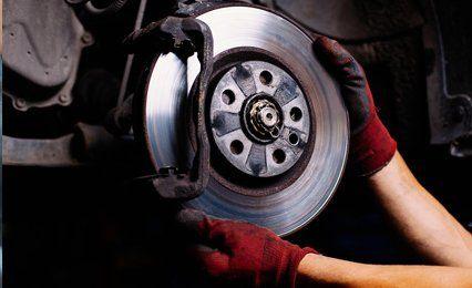 a mechanic fixing a wheel