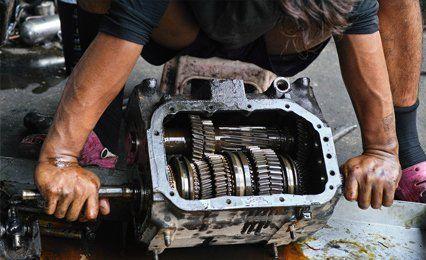 a mechanic fixing a clutch
