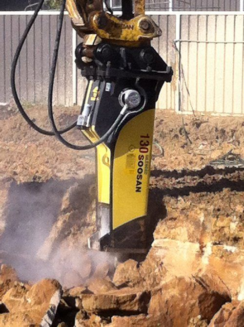 View of the hydraulic hammer working on the project site